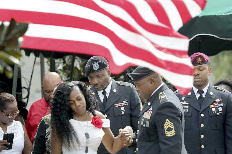 Myeshia Johnson, the wife of Army Sgt. La David Johnson, looks down at his casket after his burial at the Hollywood Memorial Gardens in Hollywood, Florida