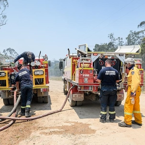 Rural fire fighters refill their fire trucks