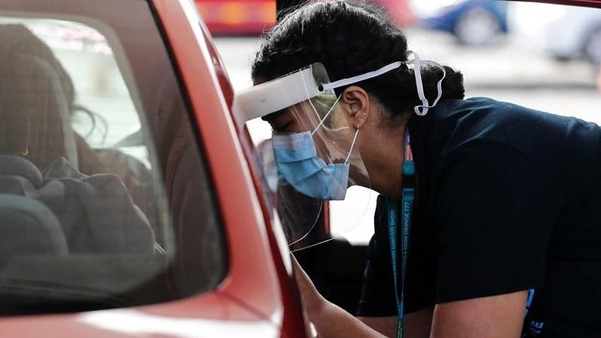 A nurse takes a COVID-19 swabs in NZ.