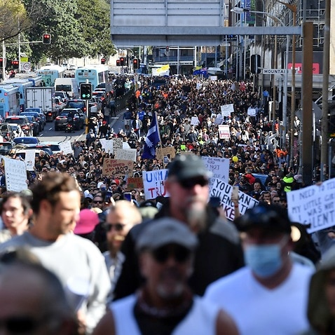 Anti-lockdown protesters march along Broadway and George St towards Sydney Town Hall on 24 July 2021.