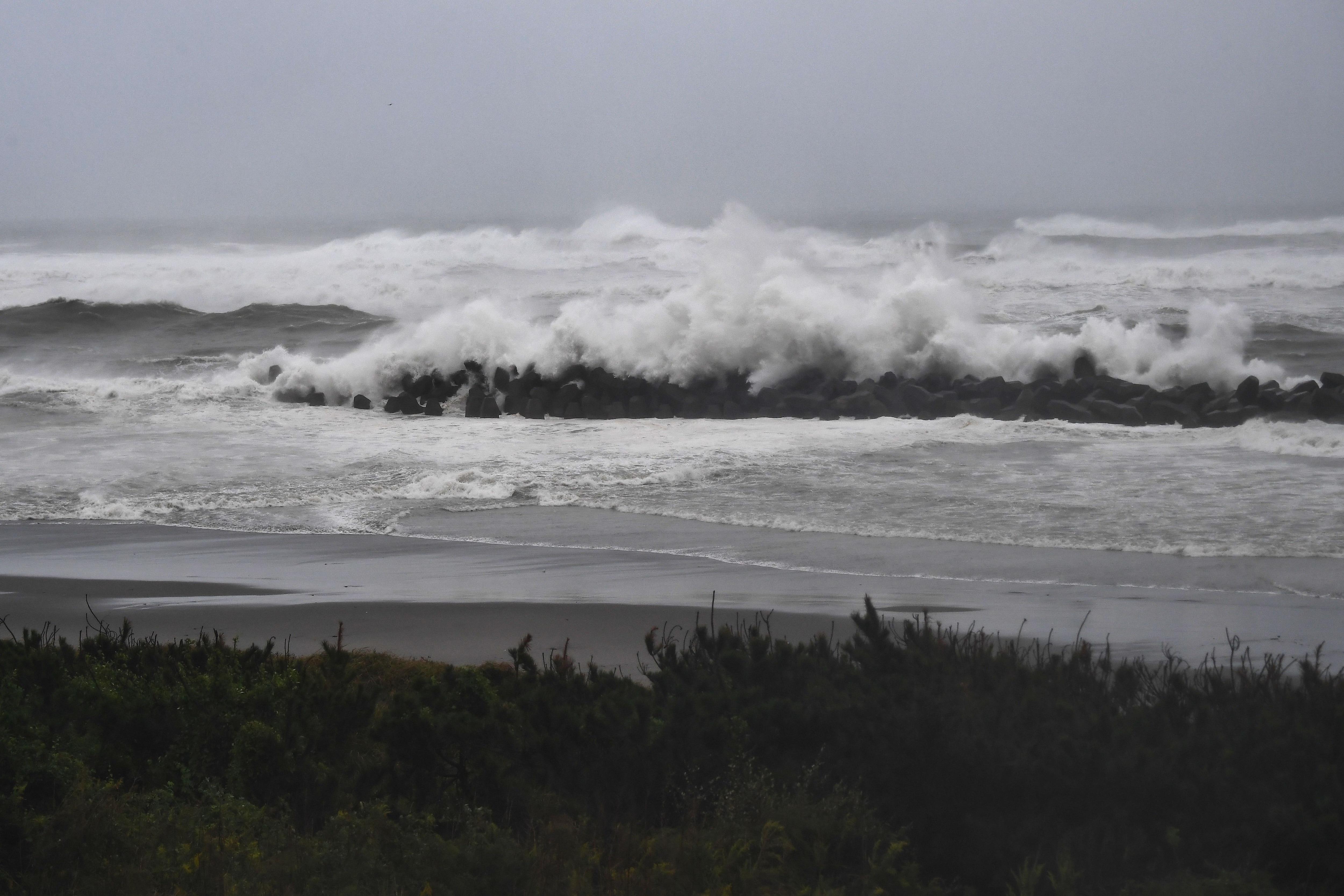 Strong waves hit a seawall along the coast in Hamamatsu.