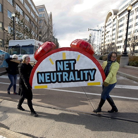Americans protesting the FCC's decision to scrap net neautrality laws in Washington.