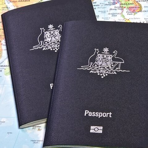 Two passport on a map of the world