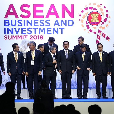 Thailand's Prime Minister Prayut Chan-o-cha (C) poses for a group photo with attendees during the opening ceremony of ASEAN Business and Investment Summit 2019.