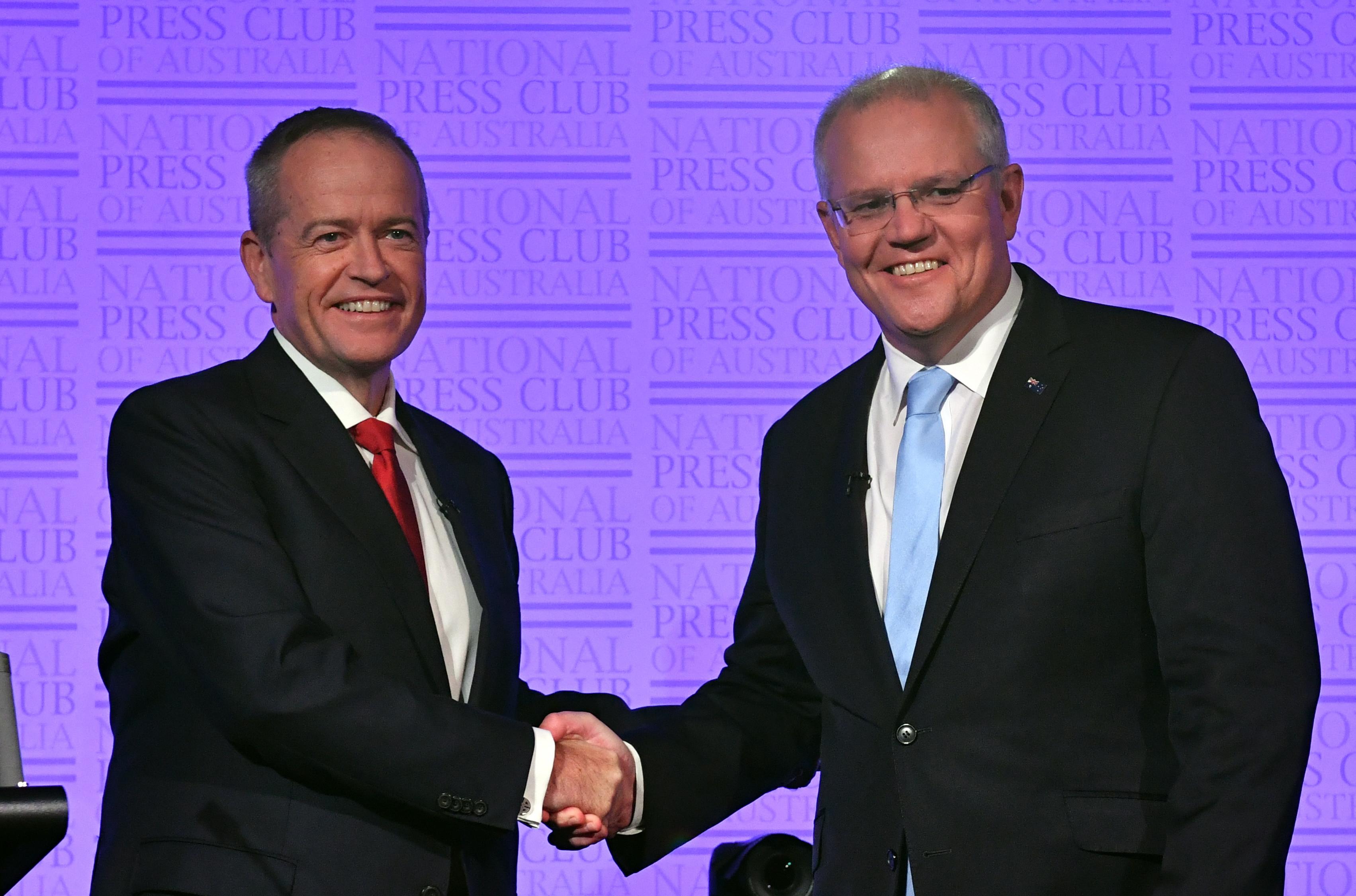 Leader of the Opposition Bill Shorten and Prime Minister Scott Morrison shake hands before the third Leaders Debate at the National Press Club in Canberra, Wednesday, May 8, 2019. (AAP Image/Mick Tsikas) NO ARCHIVING