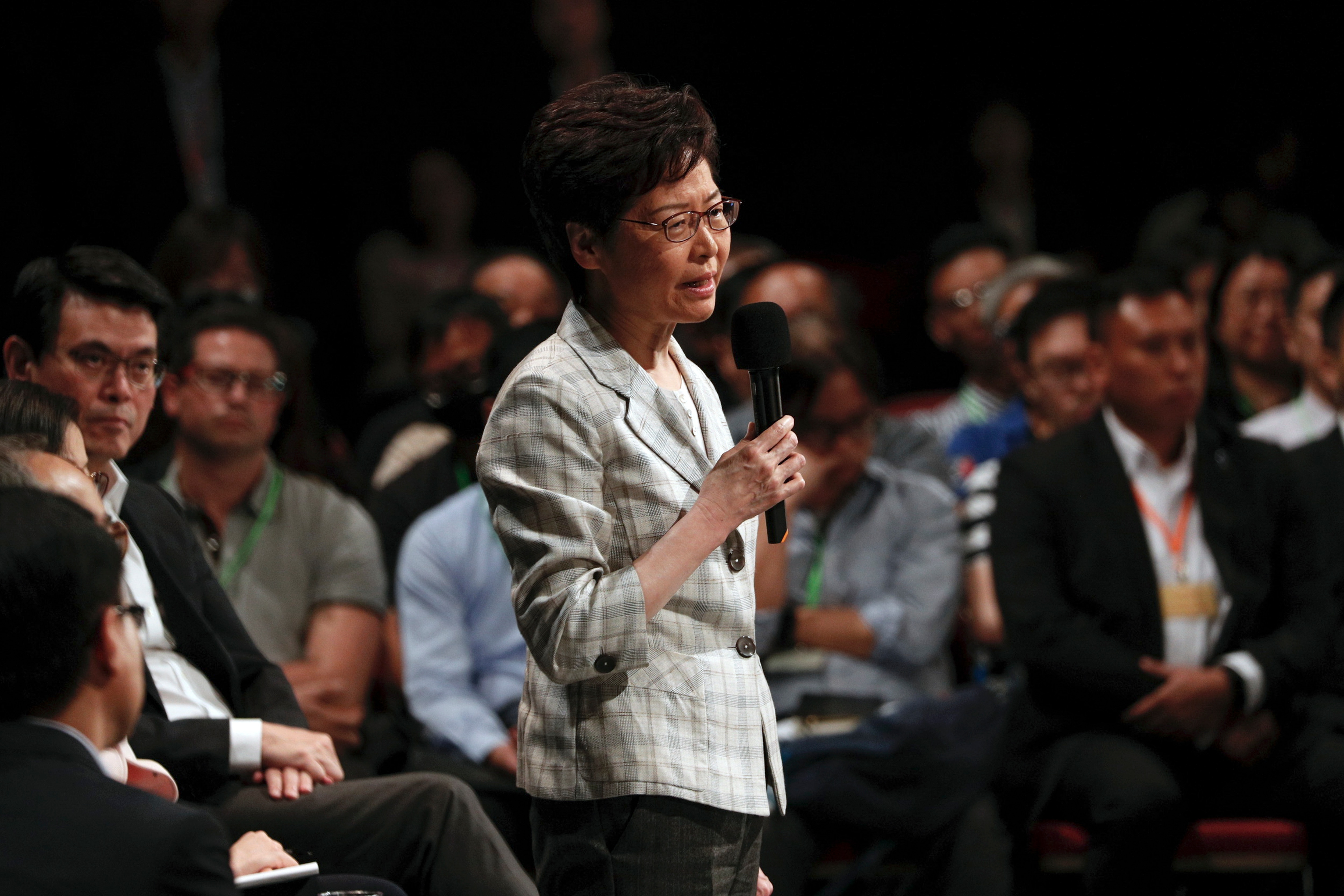 Hong Kong Chief Executive Carrie Lam speaks during a community dialogue at the Queen Elizabeth Stadium in Hong Kong.