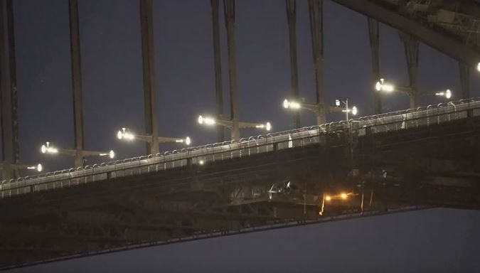 Activists scale Sydney Harbour Bridge over climate change