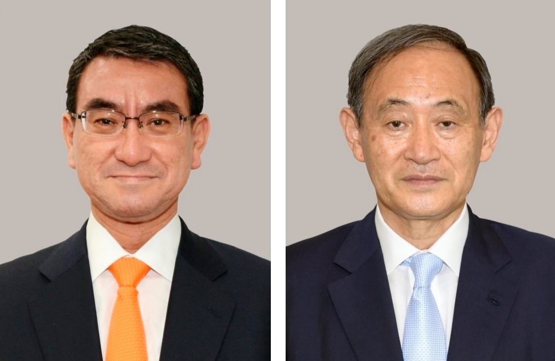 Combined file photo shows Japanese Defense Minister Taro Kono (L) and Chief Cabinet Secretary Yoshihide Suga, who are among the candidates to succeed Abe.