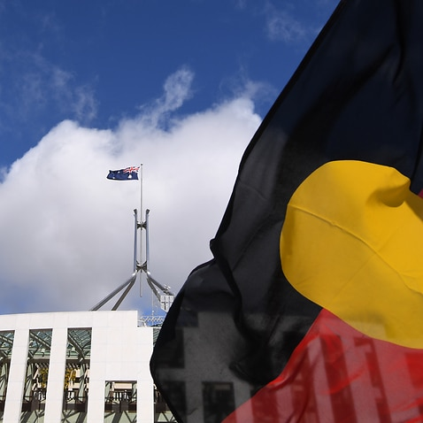 The Aboriginal flag flies outside Parliament House