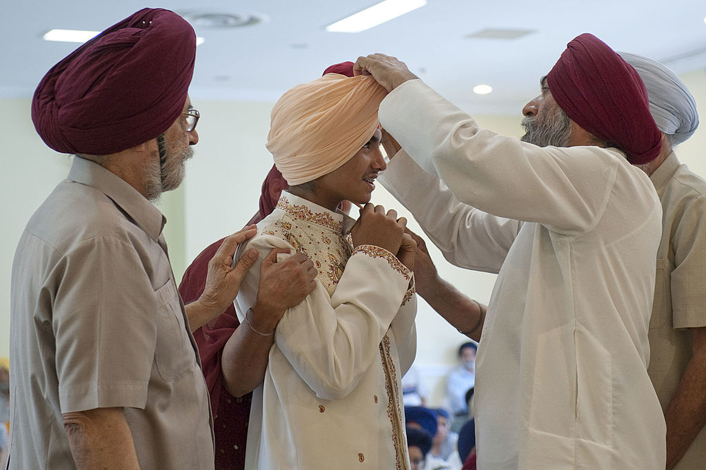 Boy participating in his Dastar Bandi a ceremony unique in the Sikh community where a young male decides to start wearing a turban.