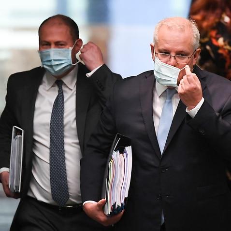 Australian Prime Minister Scott Morrison (right) and Australian Treasurer Josh Frydenberg at Parliament House in Canberra