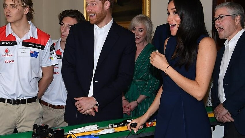 Harry and Meghan during a demonsration of F1 in Schools.