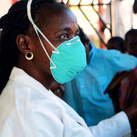 A nurse attends to displaced people suspected to have cholera in a compound in Beira, in Mozambique