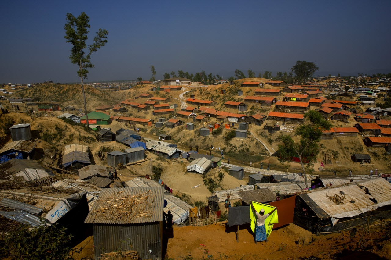 A Rohingya refugee puts up a blanket for drying at Balukhali refugee camp 50 kilometres (32 miles) from, Cox's Bazar, Bangladesh Tuesday, Jan. 23, 2018.