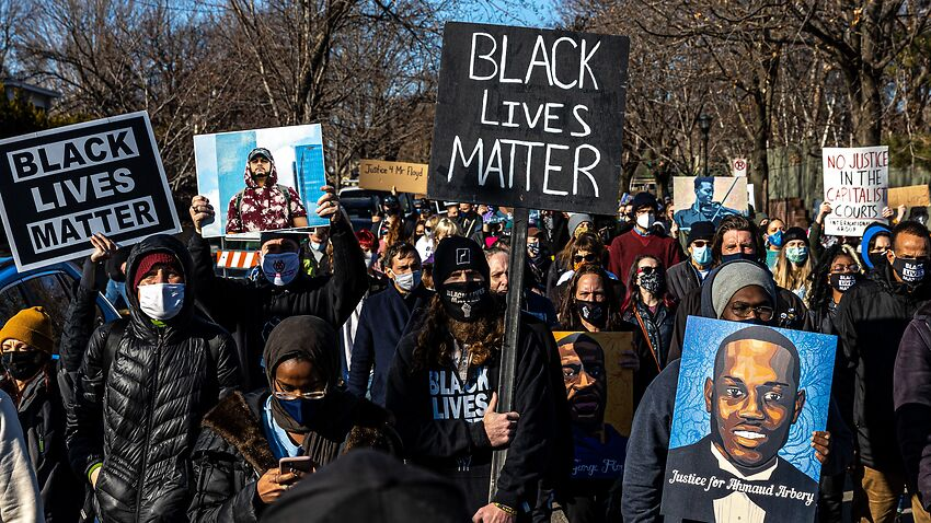 Demonstrators march on Saturday ahead of former police officer Derek Chauvin's trial.
