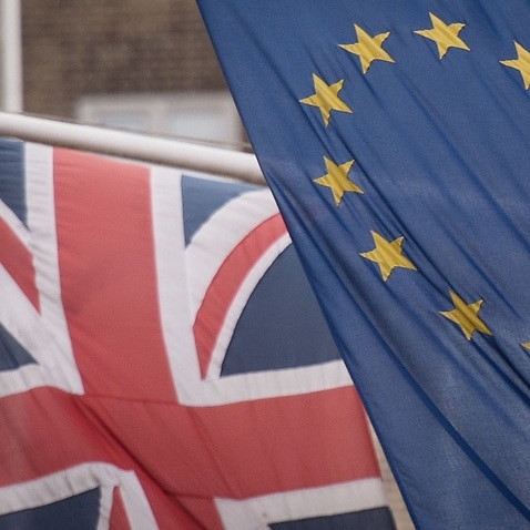 The EU takes issue of with a top minister's suggesting that London could back out of its Brexit divorce promises.