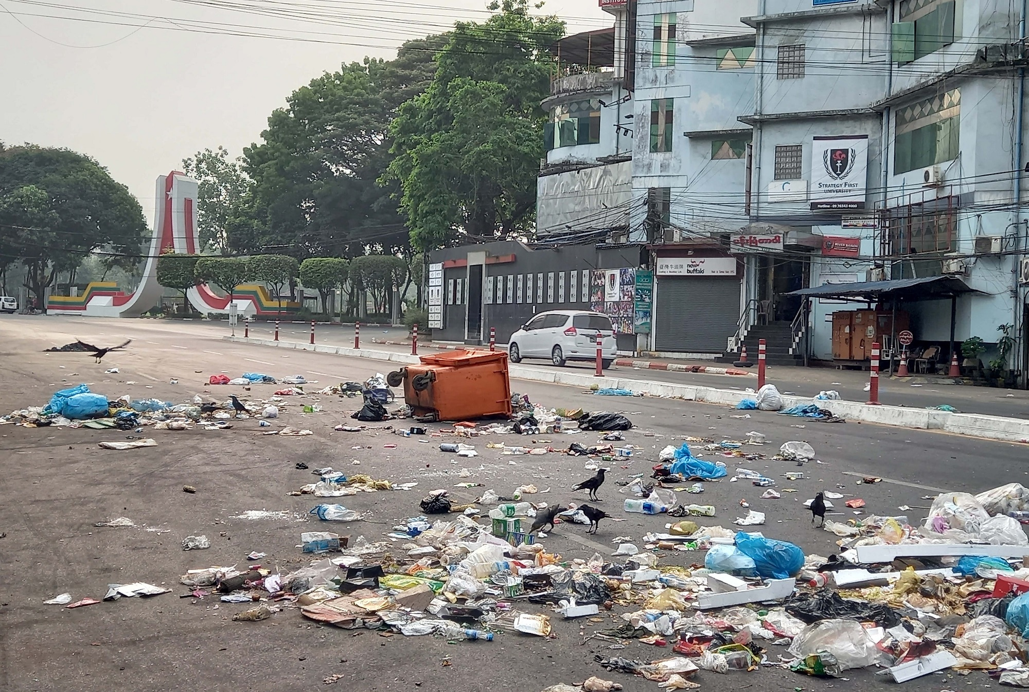 Protesters throw the garbage on the road as a protest against the military coup in Yangon, Myanmar, 30 March 2021.