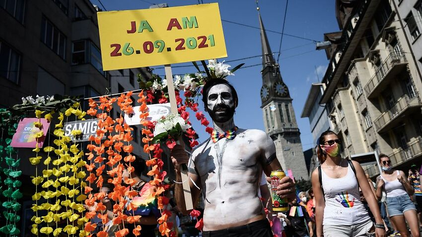 Members of lesbian, gay, bisexual, transgender, intersex and queer (LGBTIQ+) community take part in the Zurich Pride on September 4, 2021 ahead of a nationwide same-sex marriage vote.