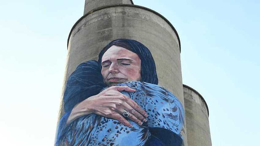 It's finished: a giant mural depicted New Zealand Prime Minister Jacinda Ardern embracing a Muslim woman has been unveiled in Melbourne.