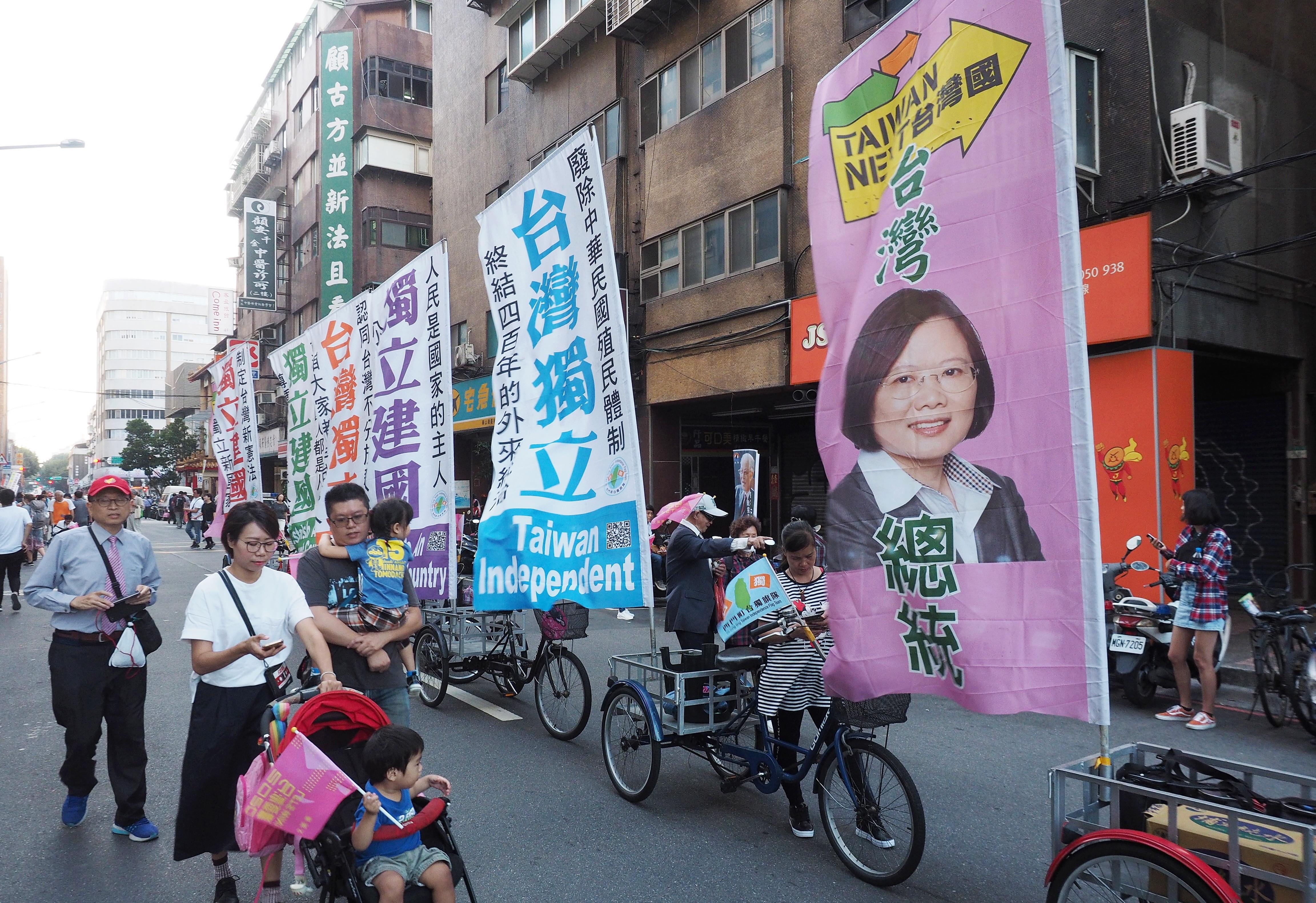 Banners showing Taiwan's President Tsai Ing-wen are on display near Tsai's campaign rally in Taipei, Taiwan, 17 November 2019.