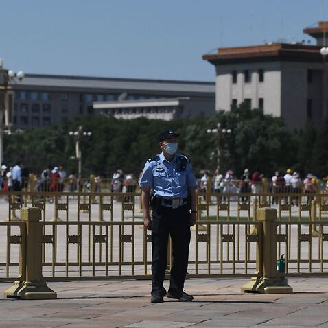 Police keep watch in Tiananmen Square in Beijing on June 4, 2021, the 32nd anniversary of the deadly 1989 crackdown on pro-democracy protests.