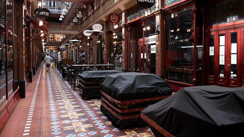 Empty cafe seating areas are seen at the Strand Arcade in Sydney during lockdown.