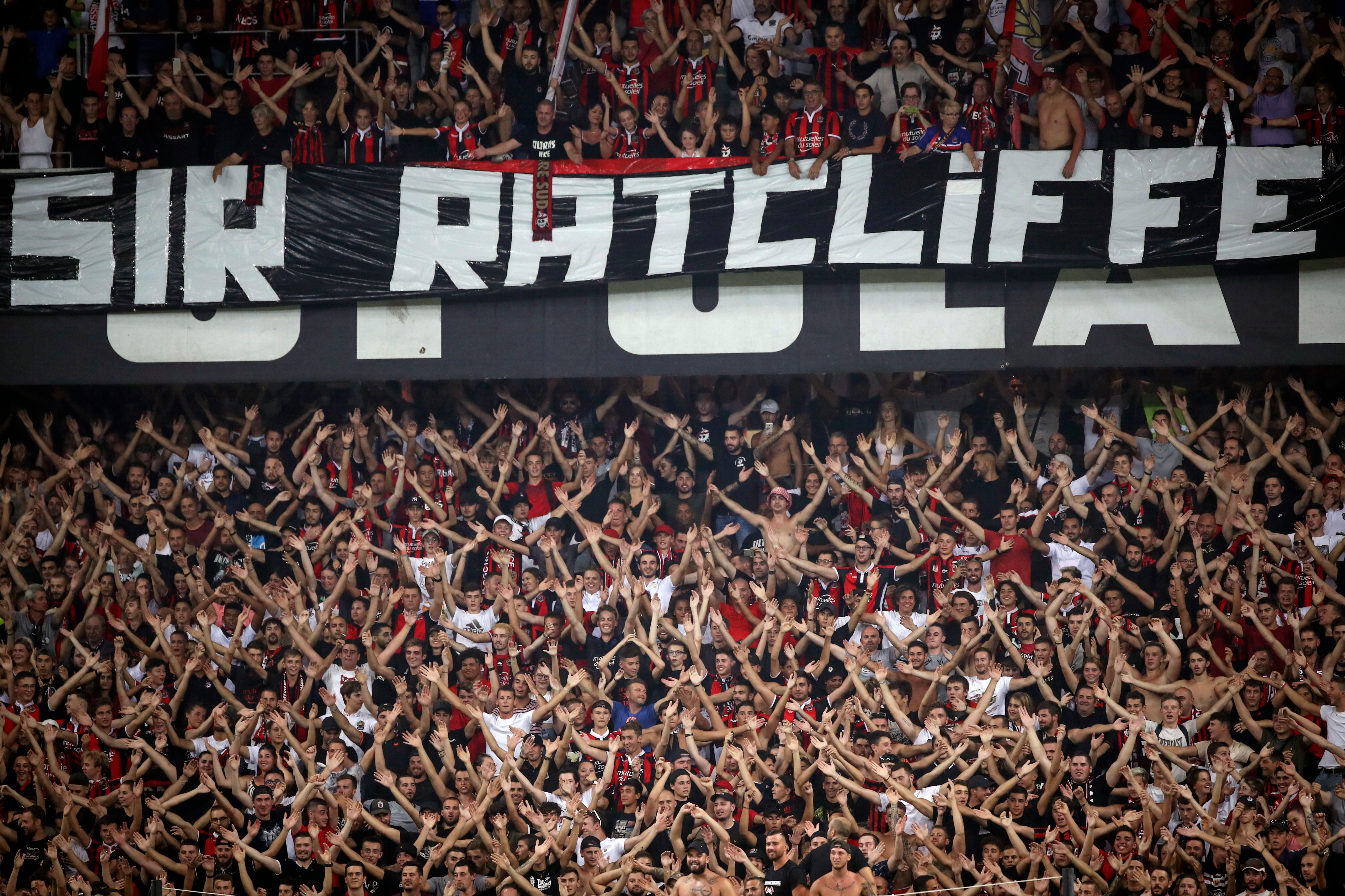 """Nice soccer fans cheer beneath a banner that reads """"Sir Ratcliffe"""" during the French League One soccer match."""