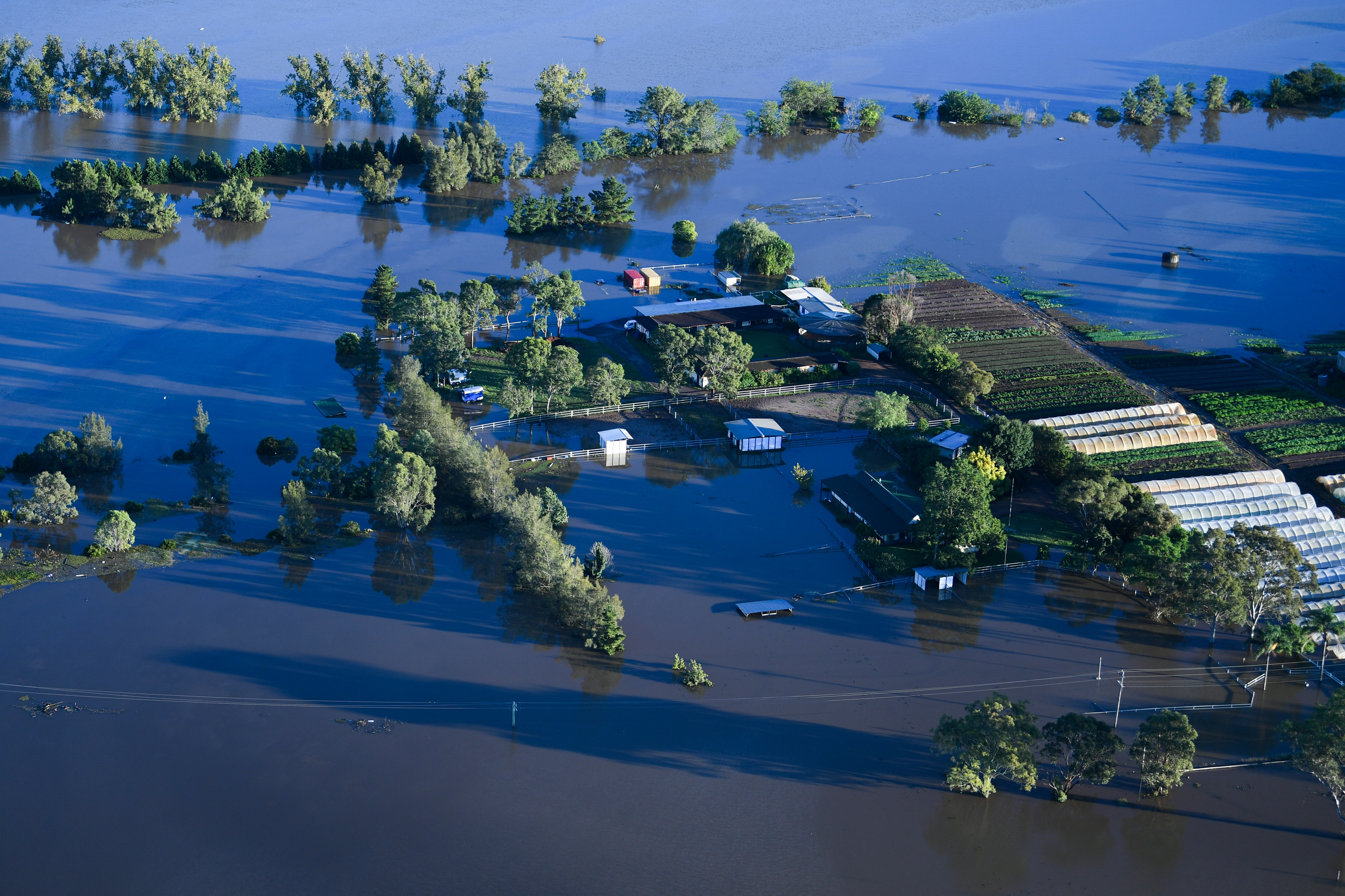 Flood affected areas are seen from a helicopter in the Windsor area on 24 March in Sydney.