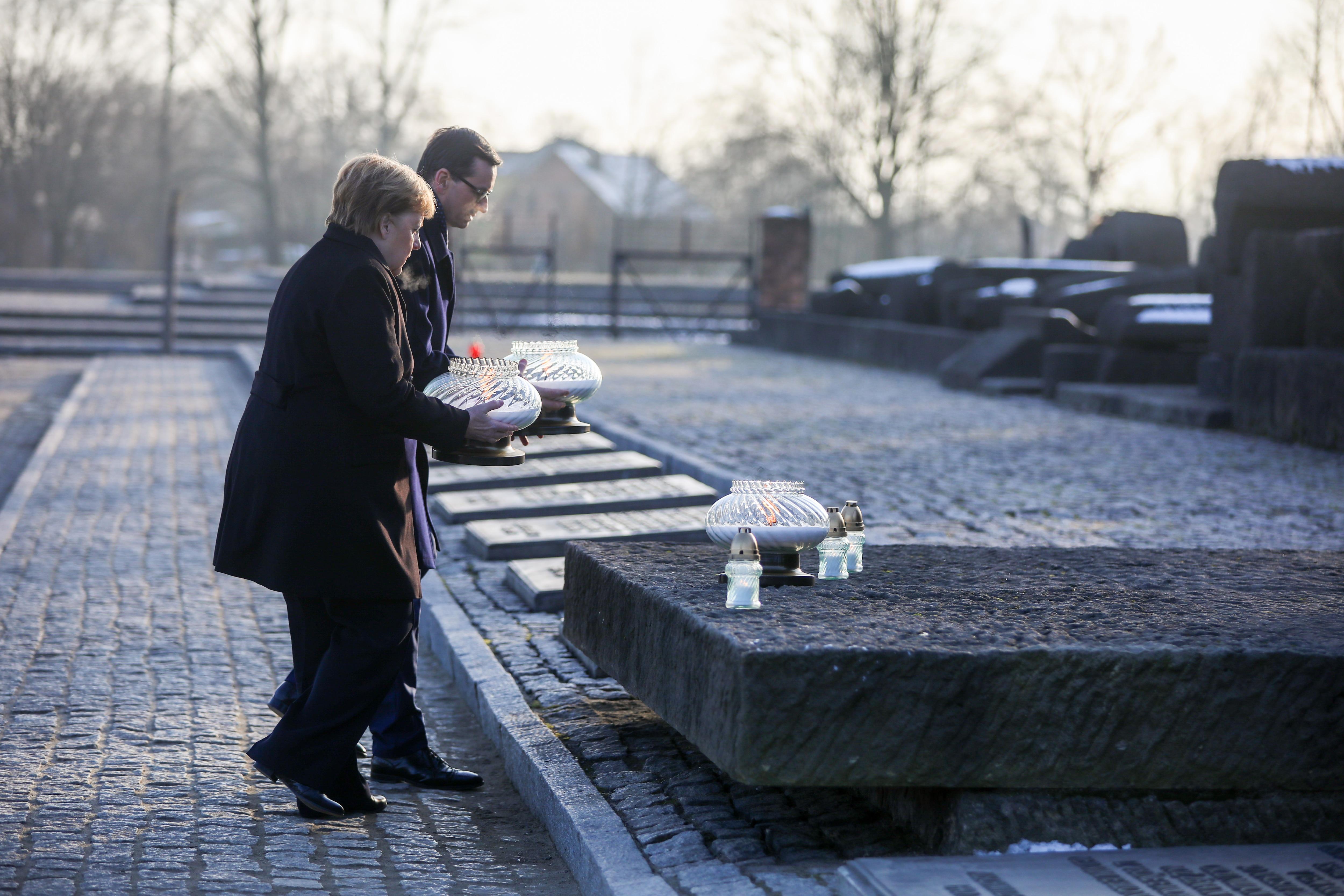 German Chancellor Angela Merkel visits the former Nazi death camp of Auschwitz.