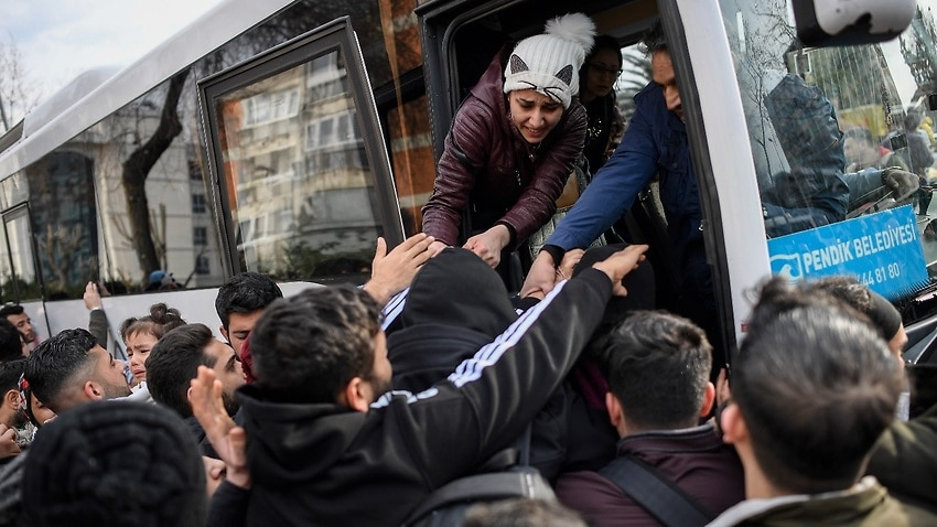 Syrian refugees board a bus as they head to border villages of Edirne province, in Istanbul, Turkey, 28 February 2020.