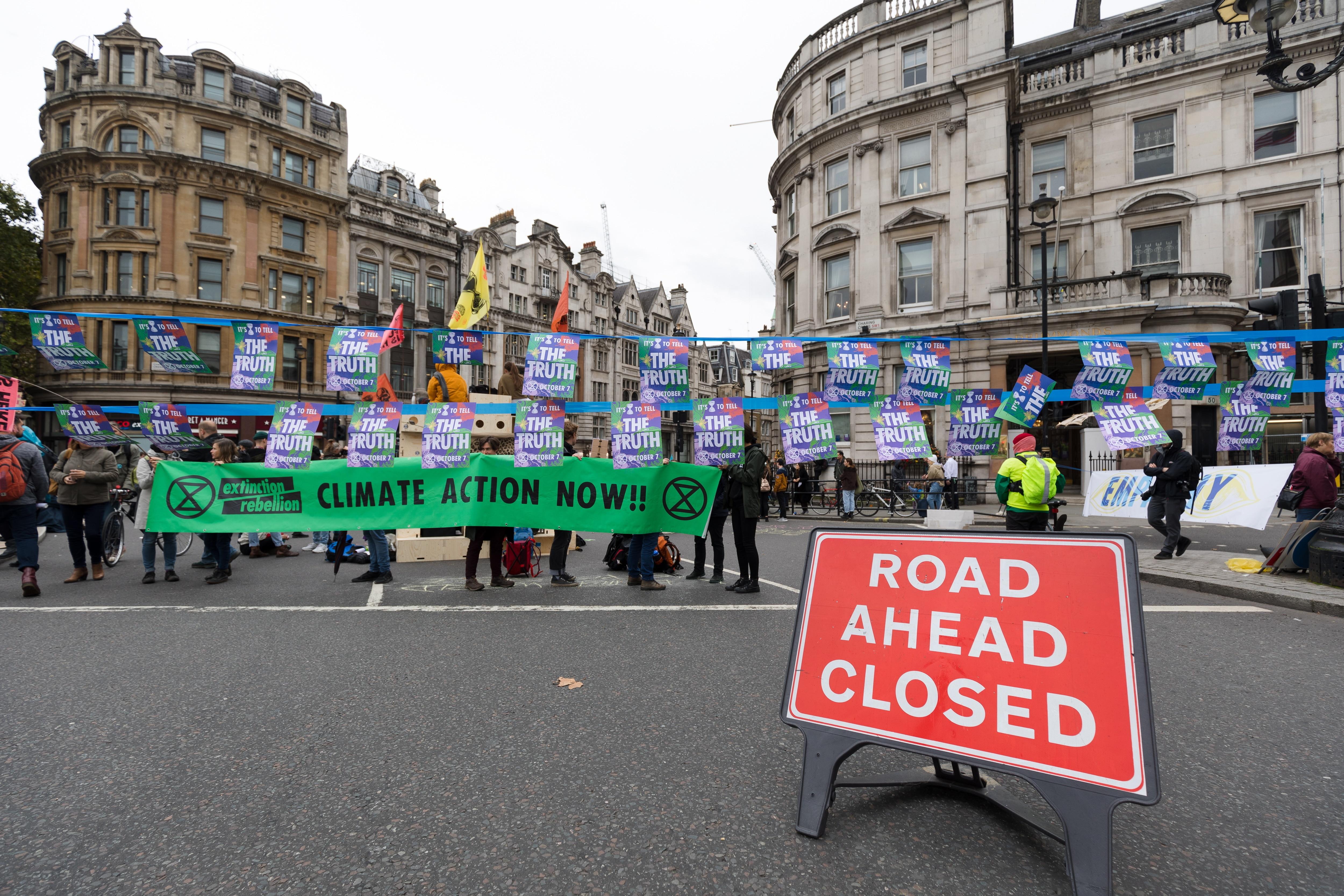Extinction Rebellion protesters block the road in Trafalgar Square in London.