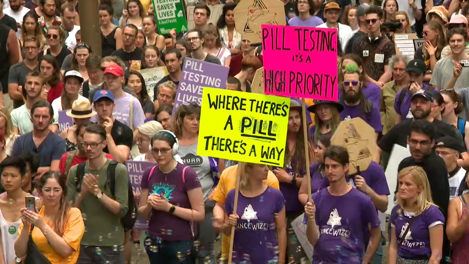 Protesters in Sydney call for the NSW government to support a pill testing trial.