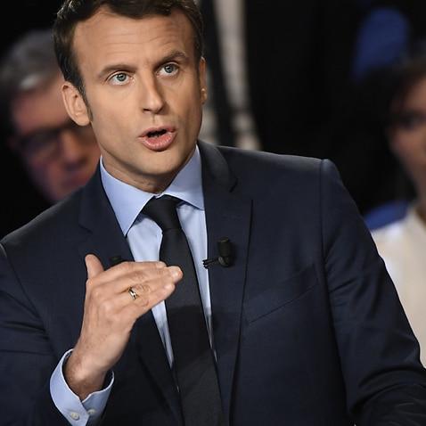 Emmanuel Macron speaks during a televised debate