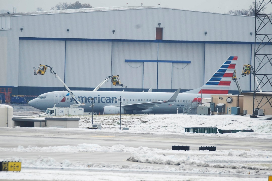 Crews move equipment into position to de-ice airplanes at Charlotte Douglas International Airport.