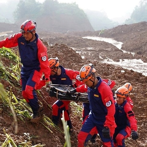 Chinese rescuers search for victims and survivors after the landslide.