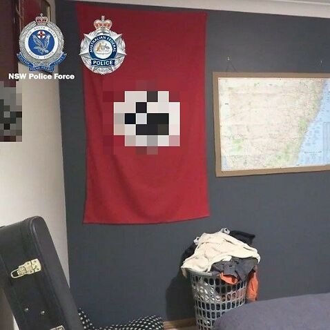 The man's bedroom had a Nazi flag and a NSW map on the walls