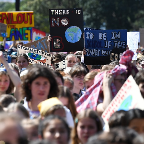 Protesters with placards participate in The Global Strike 4 Climate rally in Sydney, Friday 20 September, 2019.