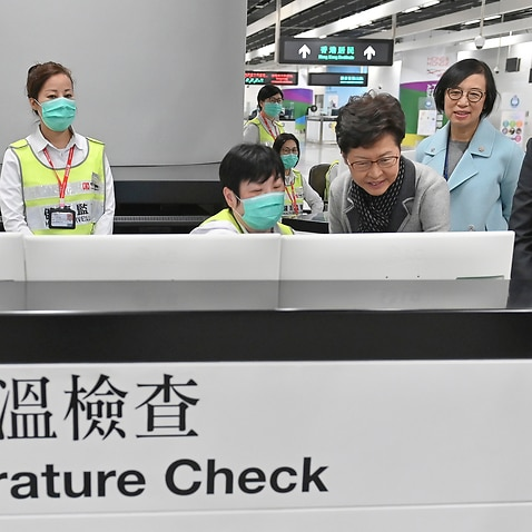 Hong Kong's Carrie Lam inspects health measures after fears a mysterious infectious disease that may have been brought back by visitors to a mainland Chinese city.
