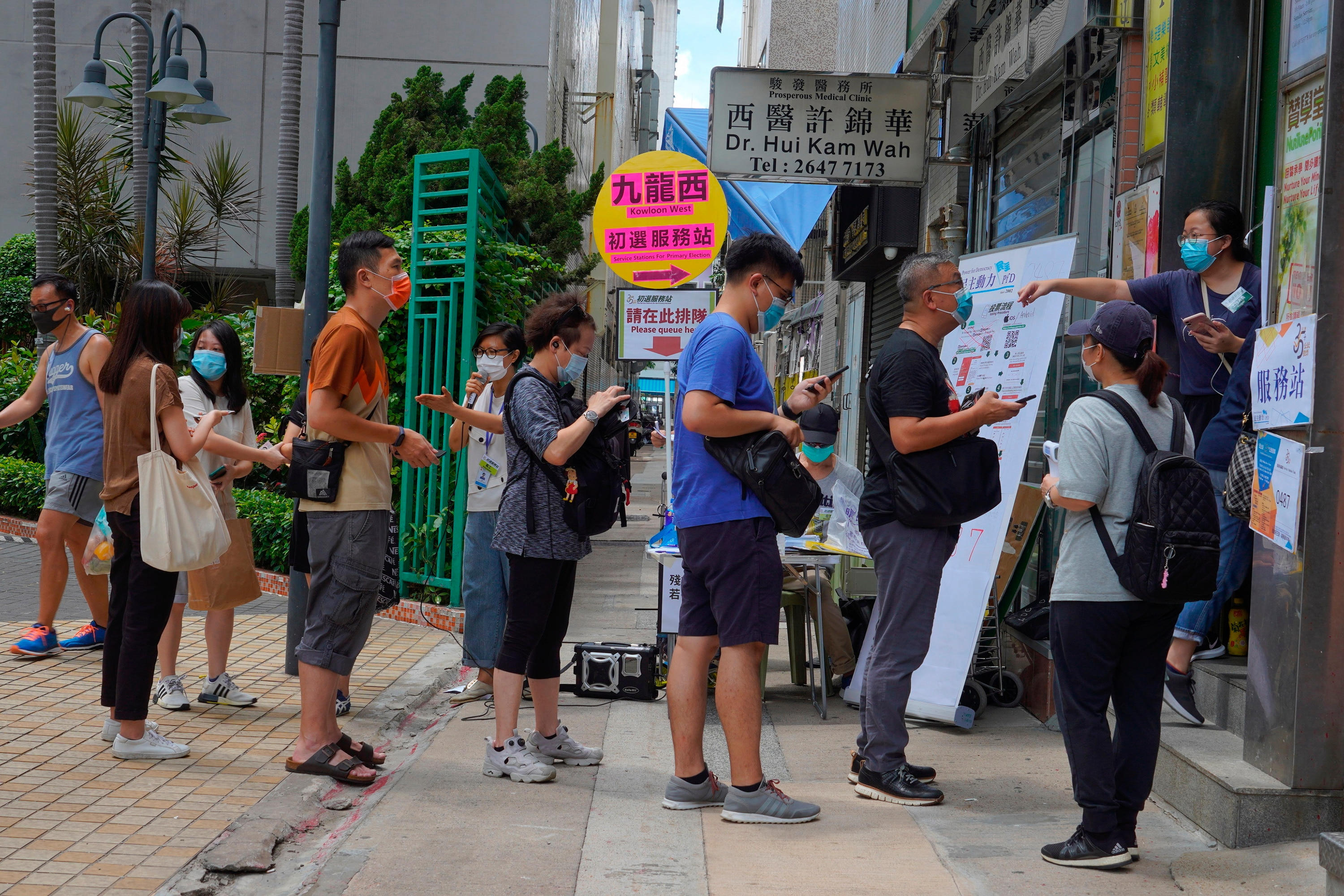 People queue up to vote in Hong Kong in an unofficial primary for pro-democracy candidates ahead of legislative elections in September.