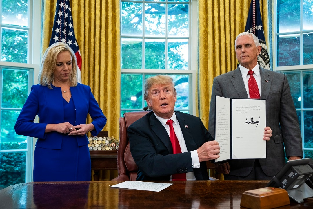The US President Donald with Homeland Security Secretary Kirstjen Nielsen and Vice President Mike Pence.