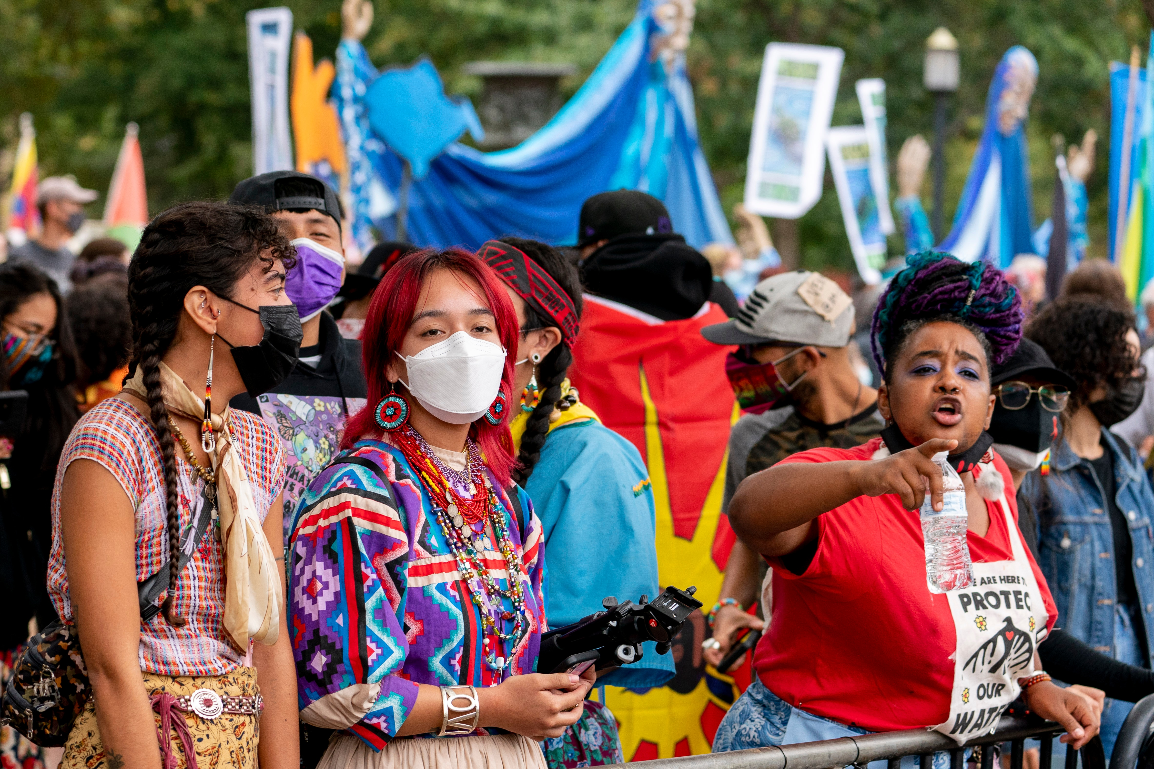 Indigenous and environmental activists protest in front of the White House in Washington DC.