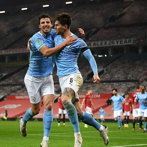 John Stones celebrates his goal against Manchester United