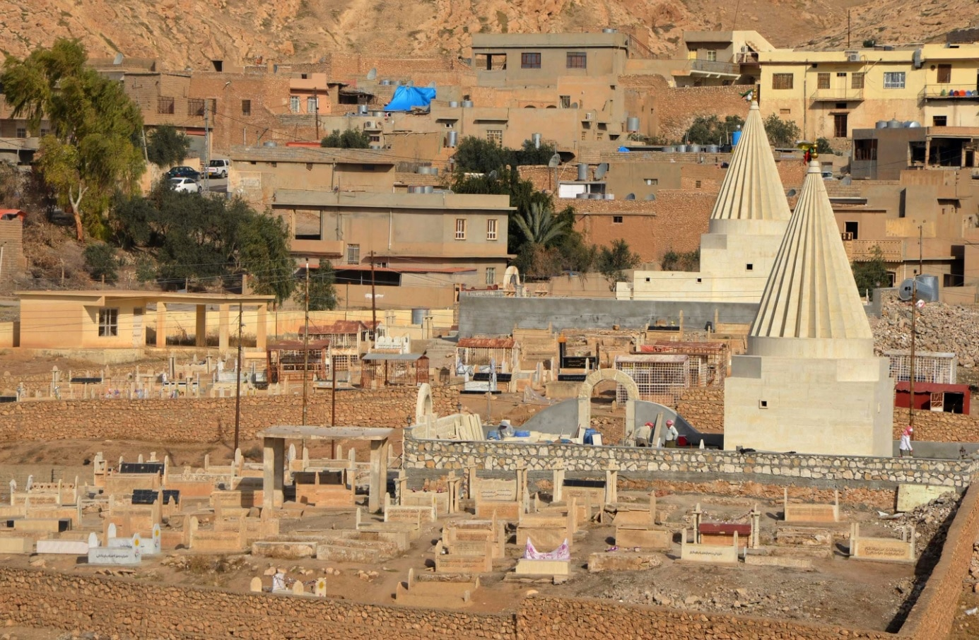 A general view shows rebuilt Yazidi temples on January 12, 2018, in the town of Bashiqa, some 20 kilometres north east of Mosul.