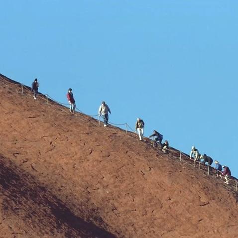 People climbing Uluru
