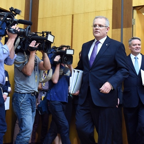 Treasurer Scott Morrison arrives to speak to journalists at a press conference during the 2016 Budget Lockup at Parliament House in Canberra