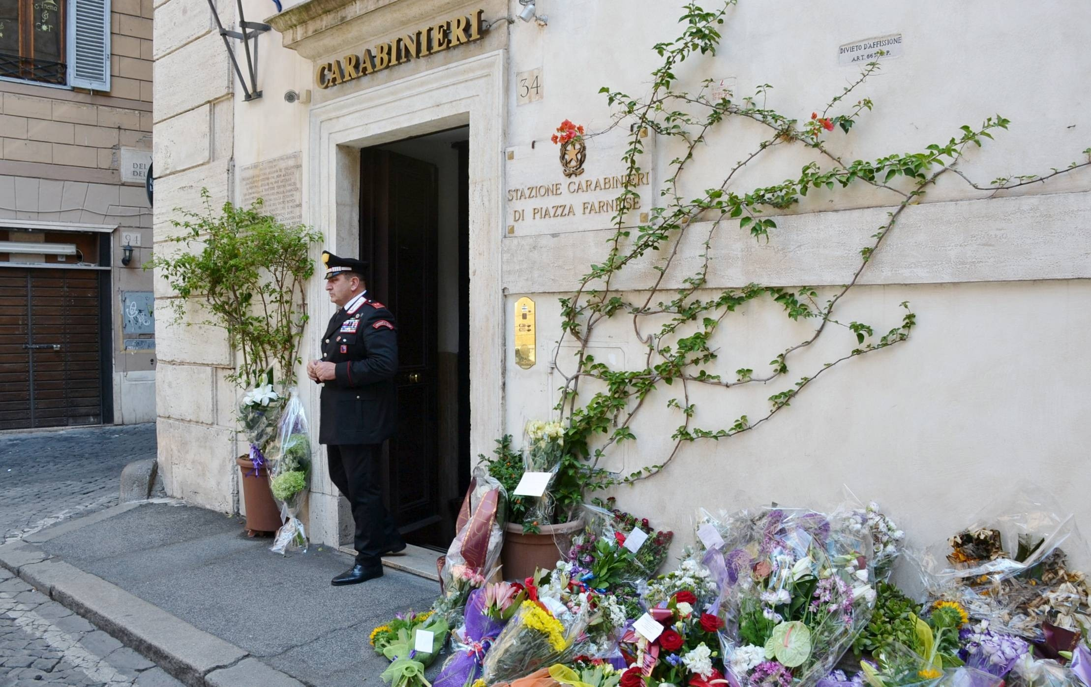 Flowers are layed out in front of the Carabinieri station in Piazza Farnese in tribute to policeman Mario Cerciello Rega who was murdered whilst trying to make an arrest in the centre of Rome..