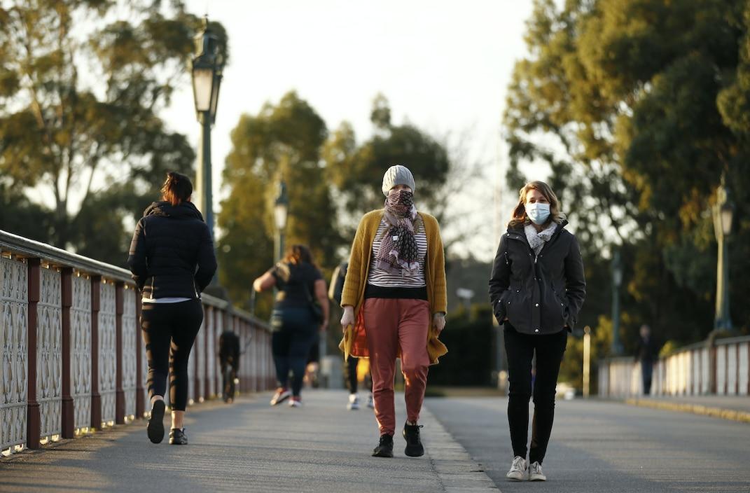 People wear masks in Melbourne.