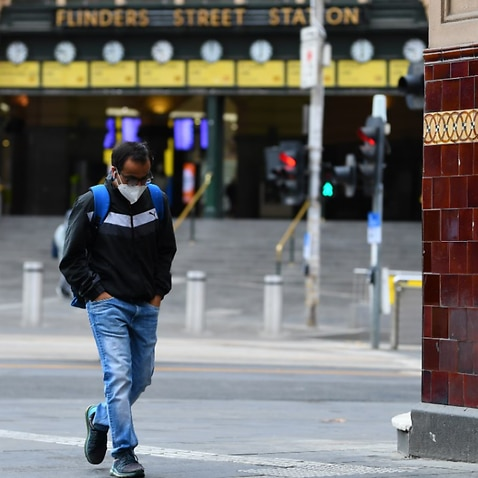 A man wearing a face mask is seen outside of Flinders Street Station in Melbourne, Thursday, August 6, 2020