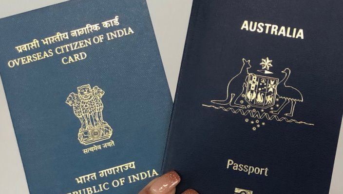OCI card which is meant to be a lifelong visa, and an Australian passport