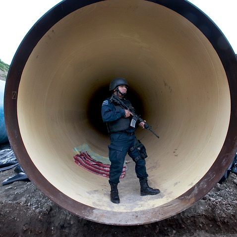 Mexican Federal Police guard a drainage pipe outside of the Altiplano maximum security prison in Almoloya, west of Mexico City